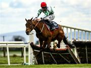 5 April 2021; The Bosses Oscar, with Jack Kennedy up, jumps the last on their way to finishing sixth in the Underwriting Exchange Hurdle during day three of the Fairyhouse Easter Festival at the Fairyhouse Racecourse in Ratoath, Meath. Photo by Harry Murphy/Sportsfile