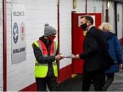 9 April 2021; FAI Chief Executive Jonathan Hill recieves a team-sheet from St Patrick's Athletic steward Colman Hanley before the SSE Airtricity League Premier Division match between St Patrick's Athletic and Derry City at Richmond Park in Dublin. Photo by Harry Murphy/Sportsfile