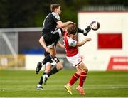 9 April 2021; Joe Thomson of Derry City in action against Matty Smith of St Patrick's Athletic during the SSE Airtricity League Premier Division match between St Patrick's Athletic and Derry City at Richmond Park in Dublin. Photo by Harry Murphy/Sportsfile