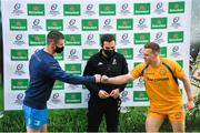 10 April 2021; Leinster captain Jonathan Sexton and Exeter Chiefs captain Joe Simmonds fist bump with Referee Mathieu Raynal at the coin toss before the Heineken Champions Cup Pool Quarter-Final match between Exeter Chiefs and Leinster at Sandy Park in Exeter, England. Photo by Ramsey Cardy/Sportsfile