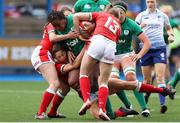 10 April 2021; Linda Djougang of Ireland is tackled by Robyn Wilkins and Hannah Jones of Wales during the Women's Six Nations Rugby Championship match between Wales and Ireland at Cardiff Arms Park in Cardiff, Wales. Photo by Chris Fairweather/Sportsfile