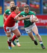 10 April 2021; Eve Higgins of Ireland is tackled by Siwan Lillicrap of Wales during the Women's Six Nations Rugby Championship match between Wales and Ireland at Cardiff Arms Park in Cardiff, Wales. Photo by Chris Fairweather/Sportsfile