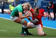 10 April 2021; Dorothy Wall of Ireland is tackled by Caryl Thomas of Wales on her way to scoring a try during the Women's Six Nations Rugby Championship match between Wales and Ireland at Cardiff Arms Park in Cardiff, Wales. Photo by Chris Fairweather/Sportsfile