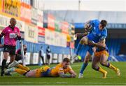 10 April 2021; Jordan Larmour of Leinster escapes the tackle of Tom O'Flaherty and Stuart Hogg of Exeter Chiefs on his way to scoring his side's third try during the Heineken Champions Cup Pool Quarter-Final match between Exeter Chiefs and Leinster at Sandy Park in Exeter, England. Photo by Ramsey Cardy/Sportsfile