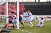 10 April 2021; Drogheda United players, from right, Chris Lyons, James Brown and Darragh Markey, celebrate their side's first goal, scored by team-mate Mark Doyle, hidden, during the SSE Airtricity League Premier Division match between Longford Town and Drogheda United at Bishopsgate in Longford. Photo by Sam Barnes/Sportsfile