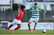 10 April 2021; Aaron Greene of Shamrock Rovers in action against Walter Figueira of Sligo Rovers during the SSE Airtricity League Premier Division match between Sligo Rovers and Shamrock Rovers at The Showgrounds in Sligo. Photo by Stephen McCarthy/Sportsfile
