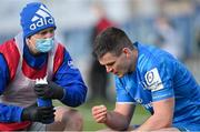 10 April 2021; Jonathan Sexton of Leinster is treated for an injury by Leinster head physiotherapist Garreth Farrell during the Heineken Champions Cup Pool Quarter-Final match between Exeter Chiefs and Leinster at Sandy Park in Exeter, England. Photo by Ramsey Cardy/Sportsfile