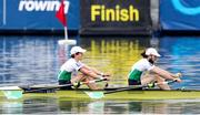 11 April 2021; Fintan McCarthy, left, and Paul O'Donovan of Ireland on their way to winning the Lightweight Men's Double Sculls A Final during Day 3 of the European Rowing Championships 2021 at Varese in Italy. Photo by Roberto Bregani/Sportsfile