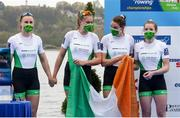 11 April 2021; Ireland rowers, from left, Aifric Keogh, Eimear Lambe, Fiona Murtagh and Emily Hegarty await their silver medals in the medal ceremony after the Women's Four A Final during Day 3 of the European Rowing Championships 2021 at Varese in Italy. Photo by Roberto Bregani/Sportsfile