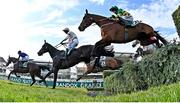 10 April 2020; Minella Times, with Rachael Blackmore up, take the water jump trailing Burrows Saint, with Paddy Mullins up, on their way to winning the Randox Grand National at the Aintree Racecourse in Liverpool, England. Photo by Hugh Routledge/Sportsfile
