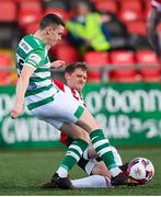 13 April 2021; Gary O'Neill of Shamrock Rovers is tackled by Ronan Boyce of Derry City during the SSE Airtricity League Premier Division match between Derry City and Shamrock Rovers at the Ryan McBride Brandywell Stadium in Derry. Photo by Stephen McCarthy/Sportsfile