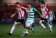 13 April 2021; Graham Burke of Shamrock Rovers in action against Ronan Boyce of Derry City during the SSE Airtricity League Premier Division match between Derry City and Shamrock Rovers at the Ryan McBride Brandywell Stadium in Derry. Photo by Stephen McCarthy/Sportsfile