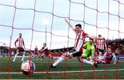 16 April 2021; James Brown of Drogheda United shoots to score his side's first goal past Derry City players, including Ciarán Coll, during the SSE Airtricity League Premier Division match between Derry City and Drogheda United at the Ryan McBride Brandywell Stadium in Derry. Photo by Stephen McCarthy/Sportsfile