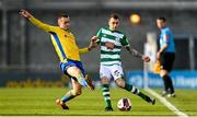 17 April 2021; Sean Kavanagh of Shamrock Rovers is tackled by Shane Elworthy of Longford Town during the SSE Airtricity League Premier Division match between Shamrock Rovers and Longford Town at Tallaght Stadium in Dublin. Photo by Eóin Noonan/Sportsfile