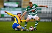 17 April 2021; Rory Gaffney of Shamrock Rovers is tackled by Karl Chambers of Longford Town during the SSE Airtricity League Premier Division match between Shamrock Rovers and Longford Town at Tallaght Stadium in Dublin. Photo by Eóin Noonan/Sportsfile