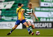 17 April 2021; Liam Scales of Shamrock Rovers in action against Aaron Dobbs of Longford Town during the SSE Airtricity League Premier Division match between Shamrock Rovers and Longford Town at Tallaght Stadium in Dublin. Photo by Eóin Noonan/Sportsfile