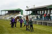 18 April 2021; Minella Times, winner of the Aintree Grand National, and Put The Kettle On, winner of the Cheltenham Champion Chase, walk past the stand at Tramore Racecourse in Waterford. Photo by Harry Murphy/Sportsfile