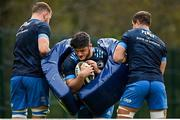 19 April 2021; Vakh Abdaladze in action against team-mates Ross Molony, left, and Scott Penny during Leinster rugby squad training at UCD in Dublin. Photo by Brendan Moran/Sportsfile