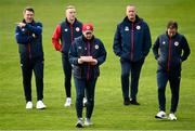 20 April 2021; St Patrick's Athletic head coach Stephen O'Donnell, third from left, with staff, from left, goalkeeping coach Pat Jennings, strength and conditioning coach Chris Coburn, manager Alan Mathews and assistant manager Patrick Cregg prior to the SSE Airtricity League Premier Division match between St Patrick's Athletic and Waterford at Richmond Park in Dublin. Photo by Harry Murphy/Sportsfile