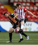 20 April 2021; Cameron McJannet of Derry City in action against Patrick Hoban of Dundalk during the SSE Airtricity League Premier Division match between Derry City and Dundalk at the Ryan McBride Brandywell Stadium in Derry. Photo by Stephen McCarthy/Sportsfile