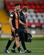 20 April 2021; Patrick Hoban of Dundalk leaves the pitch with an injury, assisted by Dundalk physiotherapist Danny Miller during the SSE Airtricity League Premier Division match between Derry City and Dundalk at the Ryan McBride Brandywell Stadium in Derry. Photo by Stephen McCarthy/Sportsfile