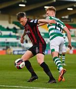 23 April 2021; Andy Lyons of Bohemians in action against Liam Scales of Shamrock Rovers during the SSE Airtricity League Premier Division match between Shamrock Rovers and Bohemians at Tallaght Stadium in Dublin. Photo by Eóin Noonan/Sportsfile