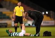 23 April 2021; Chris McCann of Shamrock Rovers receives medical attention for an injury from Shamrock Rovers physiotherapist Tony McCarthy during the SSE Airtricity League Premier Division match between Shamrock Rovers and Bohemians at Tallaght Stadium in Dublin. Photo by Eóin Noonan/Sportsfile