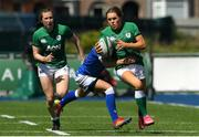 24 April 2021; Beibhinn Parsons of Ireland is tackled by Michela Sillari of Italy during the Women's Six Nations Rugby Championship Play-off match between Ireland and Italy at Energia Park in Dublin. Photo by Matt Browne/Sportsfile
