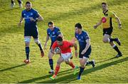 24 April 2021; Conor Murray of Munster on his way to scoring his side's first try despite the tackle of Jordan Larmour, left, and Harry Byrne of Leinster during the Guinness PRO14 Rainbow Cup match between Leinster and Munster at the RDS Arena in Dublin. Photo by Stephen McCarthy/Sportsfile