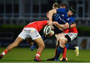24 April 2021; Ryan Baird of Leinster loses possession in a tackle by Damian de Allende, left, and CJ Stander of Munster during the Guinness PRO14 Rainbow Cup match between Leinster and Munster at the RDS Arena in Dublin. Photo by Sam Barnes/Sportsfile