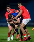 24 April 2021; Garry Ringrose of Leinster is tackled by Joey Carbery, left, and Damian de Allende of Munster during the Guinness PRO14 Rainbow Cup match between Leinster and Munster at the RDS Arena in Dublin. Photo by Stephen McCarthy/Sportsfile