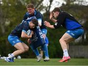 27 April 2021; Cormac Foley is tackled by Tadhg Furlong and Garry Ringrose, right, during Leinster rugby squad training at UCD in Dublin. Photo by Stephen McCarthy/Sportsfile