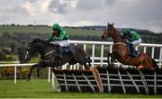 27 April 2021; Echoes in Rain, with Patrick Mullins up, clear the last ahead of eventual third Blue Lord, with Paul Townend up, on their way to winning the eCOMM Merchant Solutions Champion Novice Hurdle during day one of the Punchestown Festival at Punchestown Racecourse in Kildare. Photo by David Fitzgerald/Sportsfile