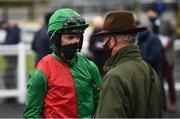 27 April 2021; Jockey Patrick Mullins speaks with trainer and father Willie Mullins after winning the eCOMM Merchant Solutions Champion Novice Hurdle during day one of the Punchestown Festival at Punchestown Racecourse in Kildare. Photo by David Fitzgerald/Sportsfile