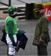 27 April 2021; Jockey Paul Townend speaks with trainer Willie Mullins following the eCOMM Merchant Solutions Champion Novice Hurdle during day one of the Punchestown Festival at Punchestown Racecourse in Kildare. Photo by David Fitzgerald/Sportsfile