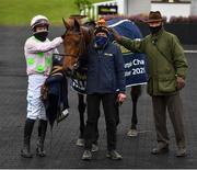 27 April 2021; Jockey Paul Townend, stablehand Vitaliy Stytsko and trainer Willie Mullins celebrate with Chacun Pour Soi after winning the William Hill Champion Steeplechase during day one of the Punchestown Festival at Punchestown Racecourse in Kildare. Photo by David Fitzgerald/Sportsfile