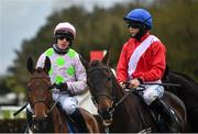 27 April 2021; Rachael Blackmore on Allaho, right, and Paul Townend on Chacun Pour Soi prior to the William Hill Champion Steeplechase during day one of the Punchestown Festival at Punchestown Racecourse in Kildare. Photo by David Fitzgerald/Sportsfile