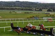 27 April 2021; Runners and riders, from left, Colreevy, with Danny Mullins up, Monkfish, with Paul Townend up, and Envoi Allen, with Rachael Blackmore up, clear the last on their first time round during the Dooley Insurance Group Champion Novice Steeplechase during day one of the Punchestown Festival at Punchestown Racecourse in Kildare. Photo by David Fitzgerald/Sportsfile