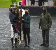 27 April 2021; Jockey Danny Mullins with Colreevy, stablehand Amy Morrissey and trainer Willie Mullins after winning the Dooley Insurance Group Champion Novice Steeplechase during day one of the Punchestown Festival at Punchestown Racecourse in Kildare. Photo by David Fitzgerald/Sportsfile