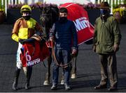 28 April 2021; Jockey Paul Townend, groom Jack Kearney and trainer Willie Mullins in the winners enclosure after sending out Galopin Des Champs to win the Irish Mirror Novice Hurdle during day two of the Punchestown Festival at Punchestown Racecourse in Kildare. Photo by David Fitzgerald/Sportsfile