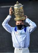 28 April 2021; Jockey Sam Twiston-Davies celebrates with the trophy after riding Clan Des Obeaux to victory the Ladbrokes Punchestown Gold Cup during day two of the Punchestown Festival at Punchestown Racecourse in Kildare. Photo by David Fitzgerald/Sportsfile