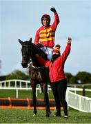 29 April 2021; Jockey Patrick Mullins and groom Eilish Byrne celebrate with Klassical Dream after winning the Ladbrokes Champion Stayers Hurdle during day three of the Punchestown Festival at Punchestown Racecourse in Kildare. Photo by Harry Murphy/Sportsfile