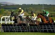 30 April 2021; Gaillard Du Mesnil, with Paul Townend up, left, jumps the last ahead of Ganapathi, with Bryan Cooper up, centre, and Ashdale Bob, with Robbie Power up, on their way to winning the Alanna Homes Champion Novice Hurdle during day four of the Punchestown Festival at Punchestown Racecourse in Kildare. Photo by Harry Murphy/Sportsfile
