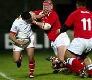 6 February 2004; Ulster's Kieran Campbell is tackled by Llaneli's Phil John. Celtic League, Ulster v Llanelli, Ravenhill Park, Belfast. Picture credit; SPORTSFILE