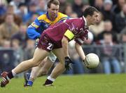8 February 2004; Westmeath's Dessie Dolan wearing an armband signifying he is a temporary substitute in action against Longford's Cathal Conefrey. Allianz National Football League, Division 1A, Westmeath v Longford, Cusack Park, Mullingar, Co. Westmeath. Picture credit; Damien Eagers / SPORTSFILE *EDI*