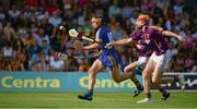 13 July 2013; John Conlon, Clare, in action against Ciaran O'Shaughnessy, 22, and Andrew Shore, Wexford. GAA Hurling All-Ireland Senior Championship, Phase III, Clare v Wexford, Semple Stadium, Thurles, Co. Tipperary. Picture credit: Ray McManus / SPORTSFILE