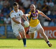 13 July 2013; Shane Mulligan, Longford, in action against James Holmes, Wexford. GAA Football All-Ireland Senior Championship, Round 2, Longford v Wexford, Glennon Brothers Pearse Park, Longford. Picture credit: Matt Browne / SPORTSFILE