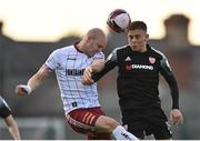 30 April 2021; Georgie Kelly of Bohemians in action against Jack Malone of Derry City during the SSE Airtricity League Premier Division match between Bohemians and Derry City at Dalymount Park in Dublin. Photo by Seb Daly/Sportsfile