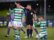 30 April 2021; Ronan Finn, left, and Graham Burke of Shamrock Rovers remonstrate with referee Rob Hennessy during the SSE Airtricity League Premier Division match between Finn Harps and Shamrock Rovers at Finn Park in Ballybofey, Donegal. Photo by Stephen McCarthy/Sportsfile