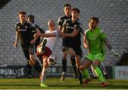 30 April 2021; Georgie Kelly of Bohemians in action against Eoin Toal and goalkeeper Nathan Gartside of Derry City during the SSE Airtricity League Premier Division match between Bohemians and Derry City at Dalymount Park in Dublin. Photo by Seb Daly/Sportsfile